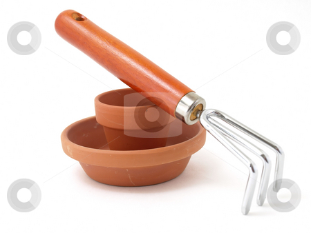 Ready to Plant stock photo, Gardening tool and terra cotta pot and saucer isolated against a white background. by Robert Gebbie