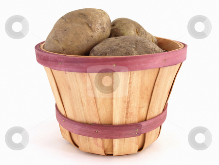 Basket of Taters stock photo, A small basket full of large brown potatoes. Studio isolated on a white background. by Robert Gebbie