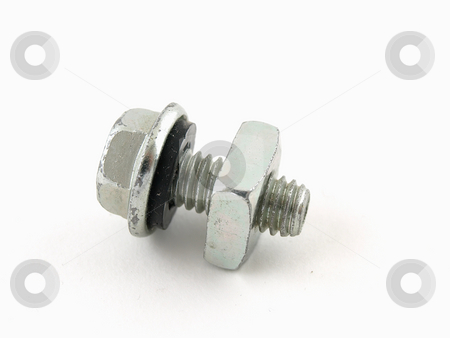 Nut and Bolt stock photo, A nut and bolt screwed together and isolated on a white background by Robert Gebbie