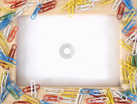 Clip Art stock photo, A tan wooden frame with colorful paperclips over a blank white background. by Robert Gebbie