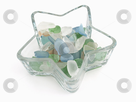 Glass Stones in Star Dish stock photo, Colorful stones of glass in various blue tones in a star shaped dish isolated over a white background. by Robert Gebbie