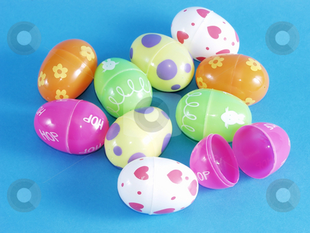 Easter Eggs stock photo, Multi colored plastic toy Easter eggs on a blue background. by Robert Gebbie