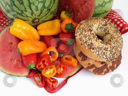 Bagels and Colorful Peppers stock photo, Beautiful red, orange and yellow peppers, ripe watermelon, and bagels set against a white background. by Robert Gebbie