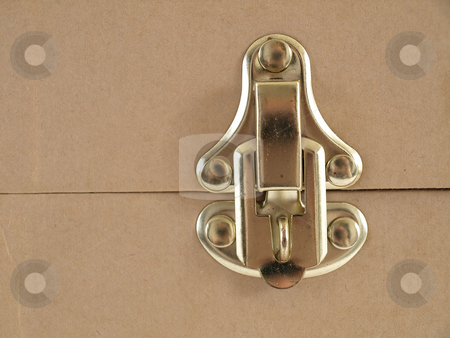 Brass Latch stock photo, Isolated view of a brass latch on a beige colored container. by Robert Gebbie