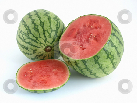 Summer Watermelons stock photo, Juicy ripe cut watermelon with a whole melon studio isolated over a white background. by Robert Gebbie
