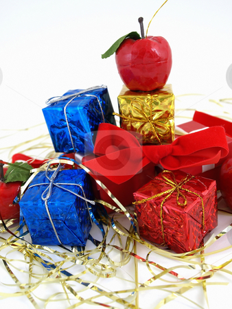 Christmas Packages stock photo, Colorful gift boxes and tinsel studio isolated against a white background. by Robert Gebbie