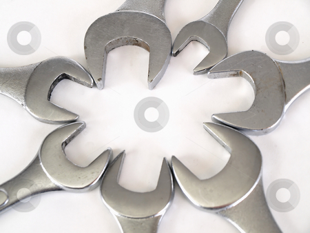 Wrench Bloom stock photo, Crescent wrenches set in a flower bloom pattern over a white background. by Robert Gebbie
