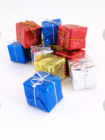 For Someone Special stock photo, Colorful gift boxes in shiny wrapping paper isolated against a white background. by Robert Gebbie
