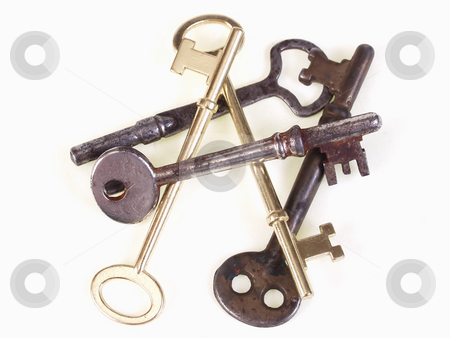 Pile of Old Keys stock photo, A group of old metal skeleton keys, isolated on a white background. by Robert Gebbie