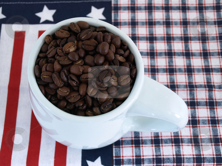 Patriotic Coffee Beans stock photo, A blue coffee cup full of rich fresh beans over a red white and blue background. by Robert Gebbie