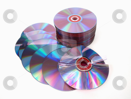 Ruptured Disc stock photo, A stack of compact discs with one in front, broken and bent, over a white background. by Robert Gebbie