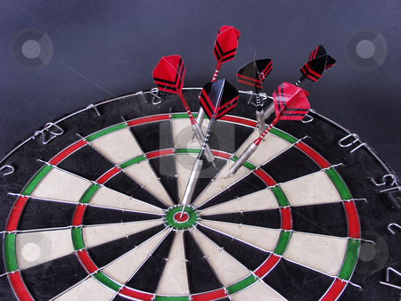 Darts 108 stock photo, A close-up of steel tipped darts in a dartboard, one with a bullseye by Robert Gebbie