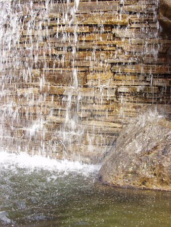 Paver Falls stock photo, Background of a small waterfall over a stone wall. by Robert Gebbie