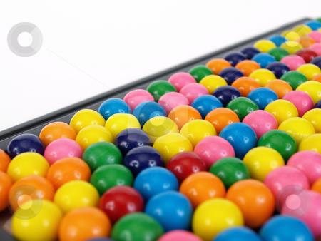 Gumball Title stock photo, A colorful variety of gumballs in a close but random pattern. On a tilt with room for text. by Robert Gebbie