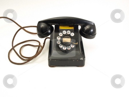 Rotary Dial Telephone stock photo, An antique black rotary dial telephone isolated against a white background. by Robert Gebbie