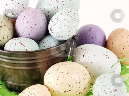 Pastel Flecked Eggs in a Pail stock photo, Pastel eggs with red and brown flecks in and out of a little metal bucket. by Robert Gebbie