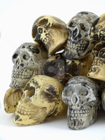 Toy Skull Formation stock photo, A pile of plastic toy skulls studio isolated over a white background. by Robert Gebbie