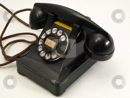 Old Retro Telephone stock photo, An antique black rotary dial telephone isolated against a white background. by Robert Gebbie
