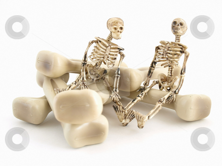 Mr and Mr Bones stock photo, Two skeleton figures sitting on some bones isolated on a white background by Robert Gebbie