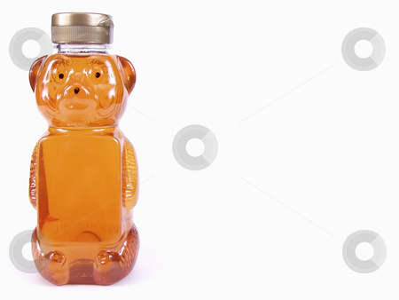 Golden Honey Bear, full, text stock photo, A bear shaped container of honey, off center with room for text on bear bottle and background. Over a white background. by Robert Gebbie