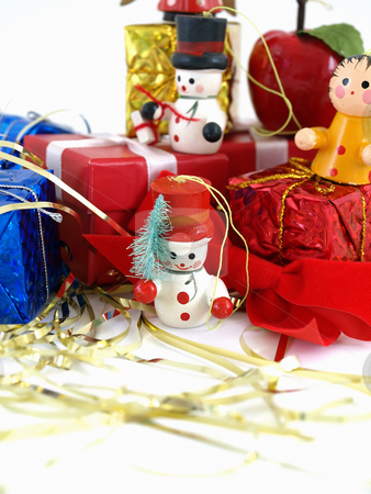Snowman Ornament stock photo, Cute colorful wooden Christmas tree ornaments, displayed with colorful wrapped presents. Over white. by Robert Gebbie