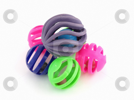 Colorful Cat Toys stock photo, Multi Colored plastic balls with bells inside. Isolated over a white background. by Robert Gebbie