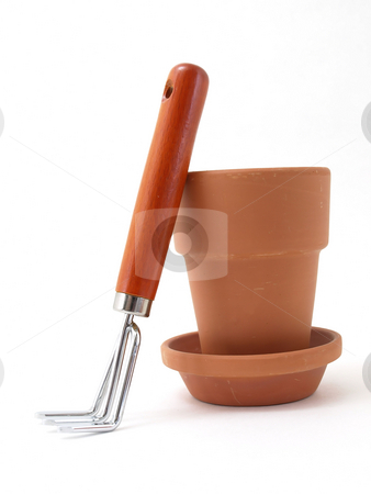 Pot and Rake stock photo, Gardening tool and terra cotta pot and saucer isolated against a white background. by Robert Gebbie