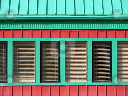 Red and Green Building stock photo, A red building with green trimmed windows, great bold box shapes for text. by Robert Gebbie