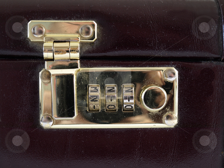 Combination Lock stock photo, Isolated view of a combination lock in a closed and locked position by Robert Gebbie