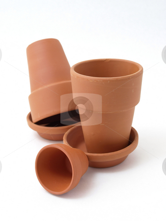Various Flower Pots stock photo, Several different sized terra cotta clay pots isolated on a white background. by Robert Gebbie
