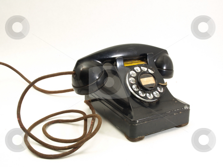 Antique Telephone stock photo, An antique black rotary dial telephone isolated against a white background. by Robert Gebbie
