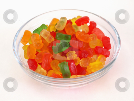 Dish of Gummy Bears stock photo, A small candy dish full of brightly colored candy bears. Over a white background. by Robert Gebbie