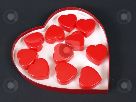 Heart of Hearts stock photo, A heart shaped box filled with red heart shapes over a black background. by Robert Gebbie