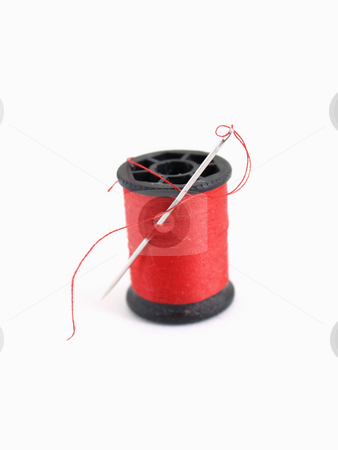 Red Thread and Needle stock photo, A spool of thread and a needle, isolated on a white background. by Robert Gebbie