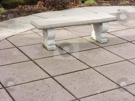 Stone Bench stock photo, A stone bench sits open and inviting, shaded, in a park. by Robert Gebbie