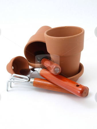 Empty Orange Gardening Pots and Tools stock photo, Several different sized terra cotta clay pots and gardening tools isolated on a white background. by Robert Gebbie
