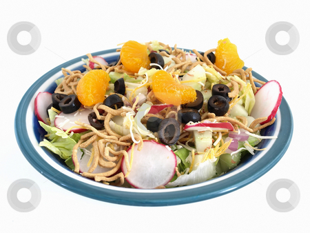 Oriental Salad on White stock photo, Crisp salad of lettuce, radishes, olives, mandarin oranges, cheese and Chinese noodles. Studio isolated over white. by Robert Gebbie