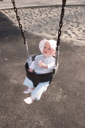 Swing stock photo, Cute little caucasian baby girl having fun on a swing by Mariusz Jurgielewicz