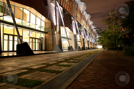 Walk In Park At Night  stock photo, A view of wide, well lit street or walkway through a park at night by Hieng Ling Tie