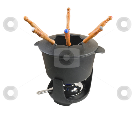 Fondue set 2 stock photo, Characteristic cast iron set used for fondue or bourguignonne on white background by ANTONIO SCARPI