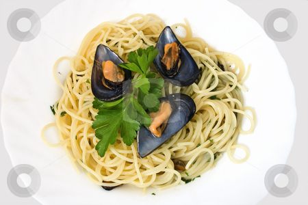 Spaghetti with mussels stock photo, Spaghetti with mussels cooked with lightly garlic, onion and parsley It's a typical italian food by ANTONIO SCARPI