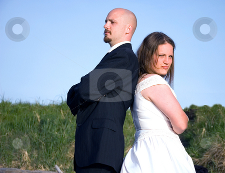 Wedding Couple Fighting stock photo, This couple in their wedding clothes are fighting and having a argument, giving the cold shoulder. by Valerie Garner