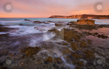 Red Dawning stock photo, A red sunrise of the limestone cliffs of PEnnington Bay, South Australia by Mike Dawson