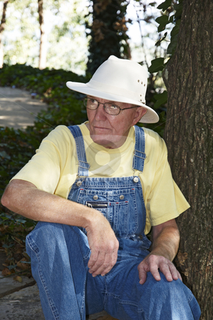 Old Man stock photo, An old man sitting in the outdoors. by Darryl Vest