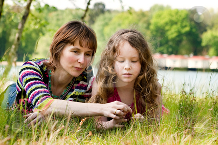 Play with the grass stock photo, Mother and daughter have a happy time together by Frenk and Danielle Kaufmann
