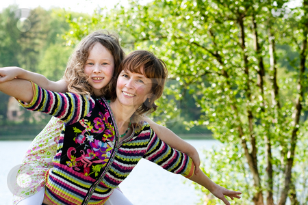 Let's fly stock photo, Mother and daughter have a happy time together by Frenk and Danielle Kaufmann