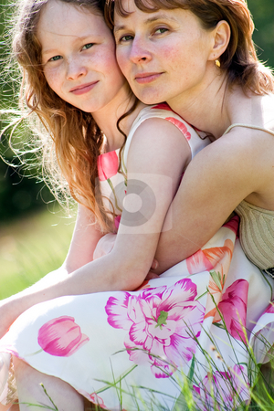 Hugging together stock photo, Mother and daughter have a happy time together by Frenk and Danielle Kaufmann