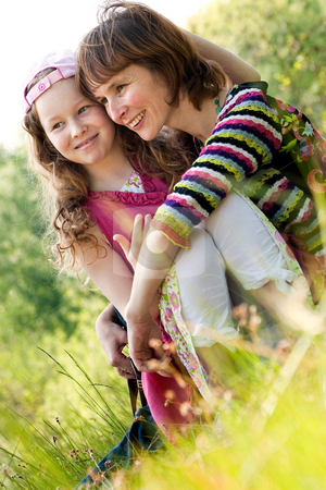 Mother and Daugther in the spring stock photo, Mother and daughter have a happy time together by Frenk and Danielle Kaufmann