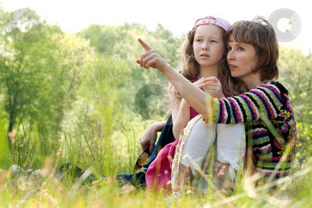 Mother is pointing stock photo, Mother and daughter have a happy time together by Frenk and Danielle Kaufmann