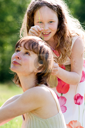 Decorating my mothers hair stock photo, Mother and daughter have a happy time together by Frenk and Danielle Kaufmann
